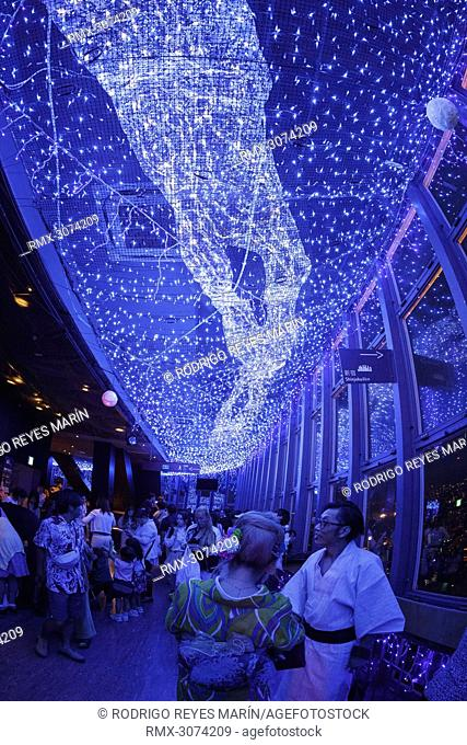 July 7, 2018, Tokyo, Japan - Visitors enjoy the Milky Way Illumination to celebrate the annual festival of Tanabata at Tokyo Tower
