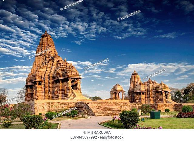 Beautiful image of Kandariya Mahadeva temple, Khajuraho, Madhyapradesh, India with blue sky and fluffy clouds in the background