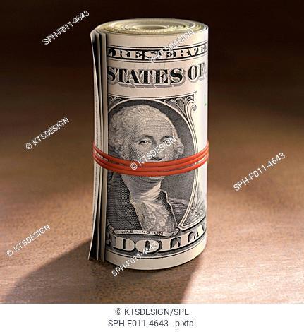 Dollar bills rolled up, computer illustration