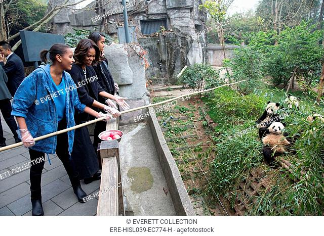 First Lady Michelle Obama, daughters Sasha and Malia feed apples to giant pandas. Giant Panda Research Base in Chengdu, China, March 26, 2014 (BSLOC-2015-3-38)