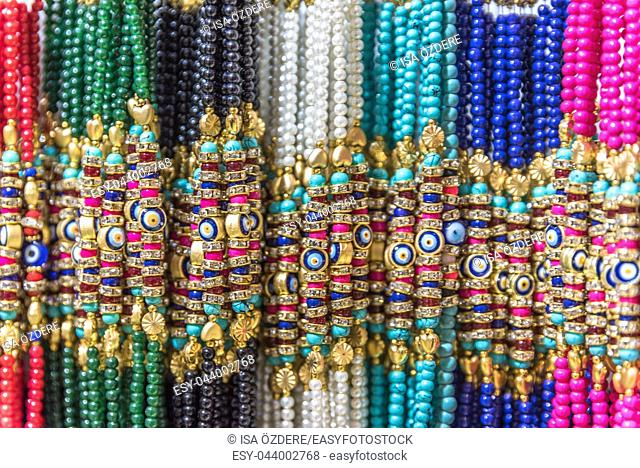 Collection of Traditional Turkish colorful bead bracelets made from glass on display for sale in a Turkish bazaar