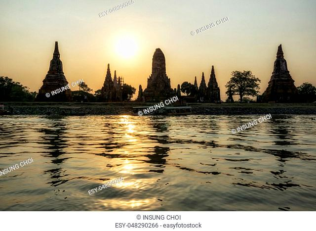 The view of Wat Chaiwatthanaram taken during sunset hours with the reflection on the chao phraya river. Ayutthaya, Thailand