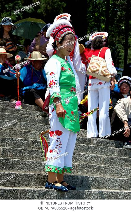 China: Bai woman at the Bai music and dance festival, San Ta Si (Three Pagodas), Dali, Yunnan