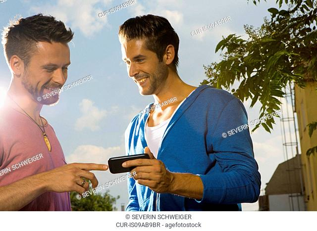 Two men with cell phone