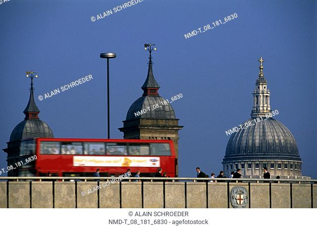 Low angle view of a bus moving on a bridge, St  Paul's Cathedral, London, England