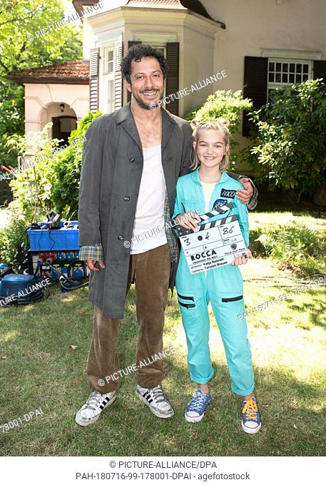"16 July 2018, Germany, Hamburg: Actors Fahri Yardim and Luna Maxeiner looking into the camera in the set of the film """"Rocca - Change the world!"""" during a..."