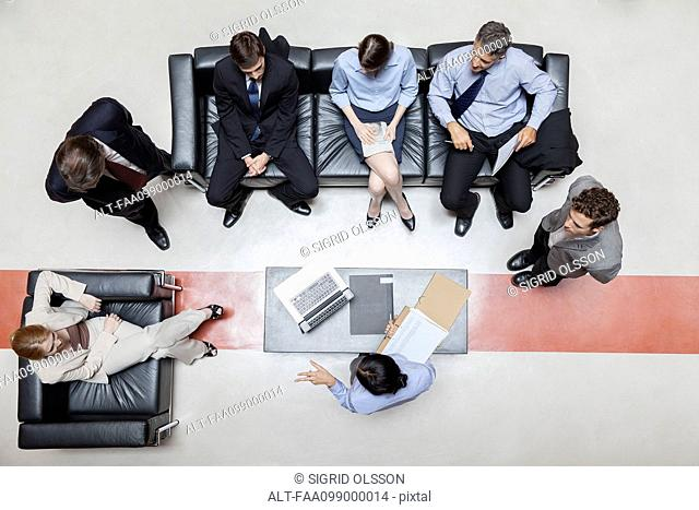 Executives in meeting, overhead view