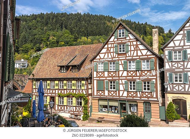 historical old town of Schiltach, Black Forest, Germany, picturesque half-timbered houses in the inner-city with hills in background