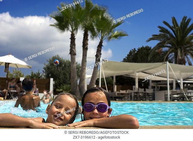 Gecko luxury boutique Hotel, Migjorn beach, Formentera Island, Balearic Islands, Spain, Europe. Girls in the swimming pool