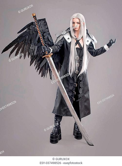 Woman warrior with sword and wings isolated on the gray background