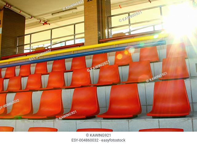 Stadium chairs under sunlight