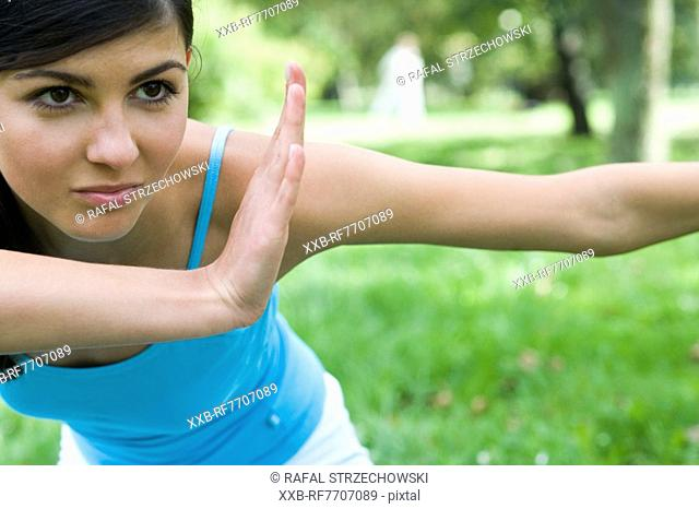 Young woman exercising in park