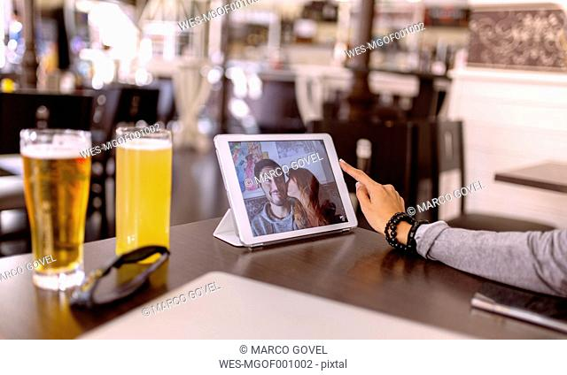 Photography of young couple on display of digital tablet