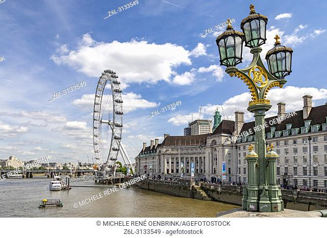The London Eye and iconic british lampost in London England
