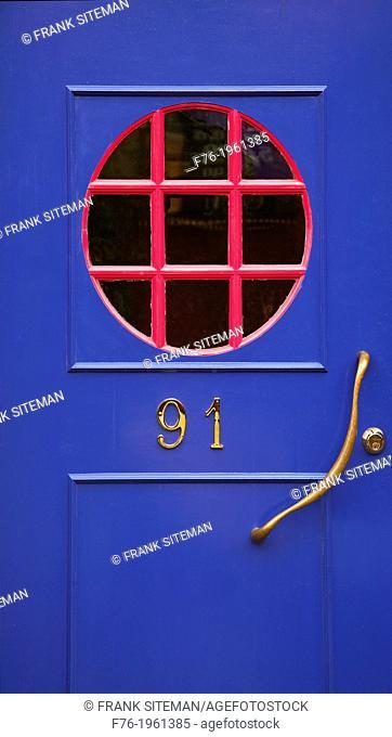 Blue door with red circular window, address is # 91