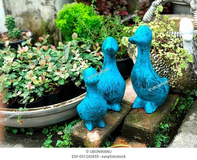 Group of blue duck figure decorated in the garden