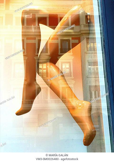 Mannequin' s legs wearing thights in a shop window. Madrid, Spain