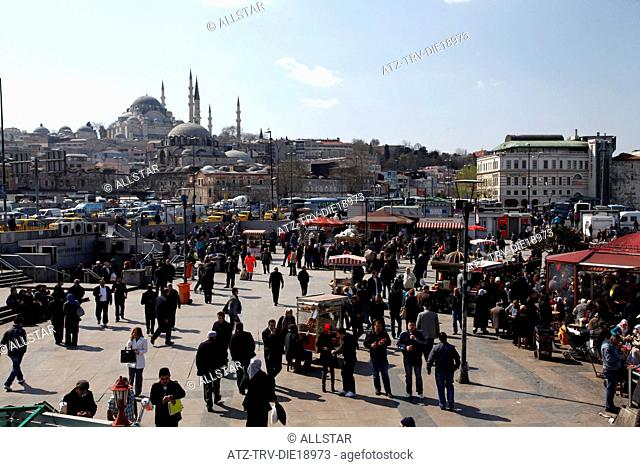 PEOPLE IN SQUARE & SULEYMANIYE & RUSTEM PASA MOSQUES; EMINONU, ISTANBUL, TURKEY; 27/03/2012