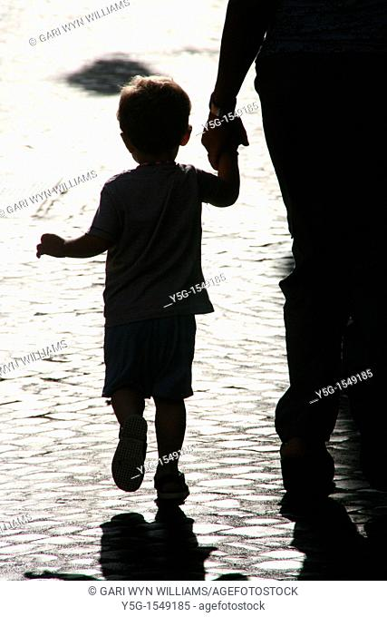 shadow of mum and child on cobbles