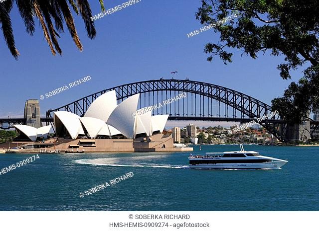 Australia, New South Wales, Sydney, Opera House created by architect Jorn Utzon listed as World Heritage by UNESCO and Harbour Bridge, boat across the bay