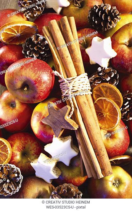 Apples, christmas cookies and cinnamon sticks