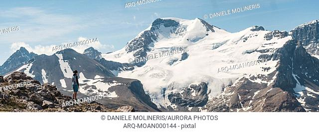 Female hiker admiring scenic view of Athabasca peak and glacier†from Wilcox Pass, Alberta, Canada
