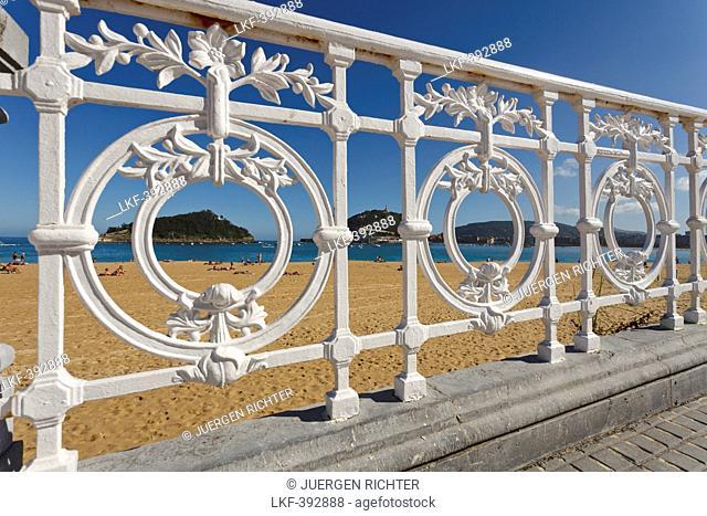 Balustrade of the seaside promenade and beach in the sunlight, Paseo de la Concha, Playa Ondarreta, Isla de Santa Clara, Bahia de la Concha, Bay of La Concha