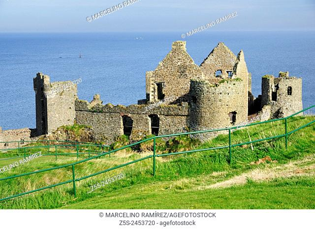 Dunluce Castle is a now-ruined medieval castle in Northern Ireland. County Antrim. United Kingdom, UK