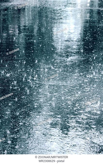 drops of rain water on wet asphalt