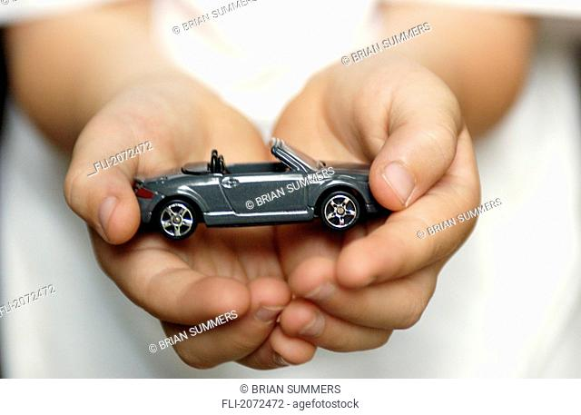 Boy With Toy Car In Hands