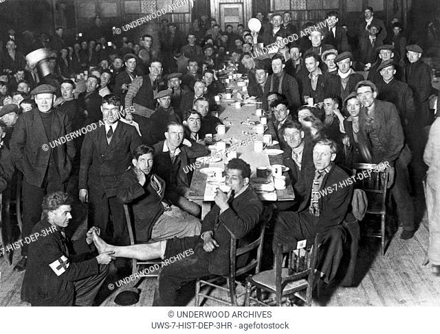 Newbury, Berkshire, England: February 19. 1934 Hunger Marchers taking a tea break on their way to London from the South Wales district to protest against the...