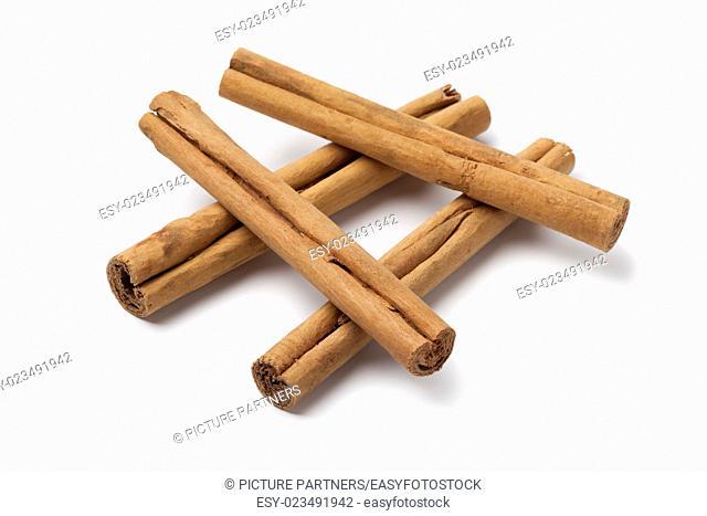 True cinnamon sticks close up on white background