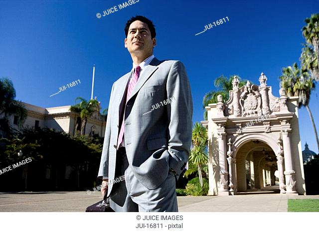 Businessman standing near historic building