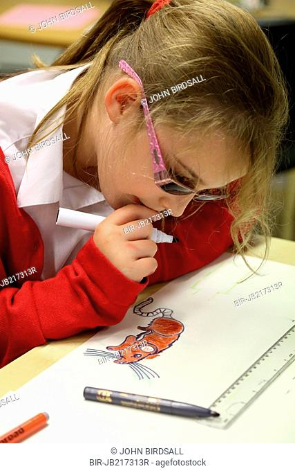 Girl drawing and colouring at Mysight charity for children with visual impairments, Nottingham