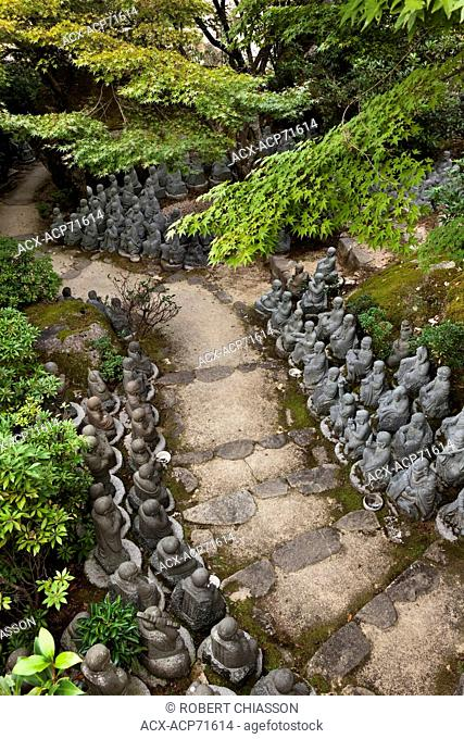 On the Daisho-in Temple grounds is a path lined with 500 Rakan statues, a sampling of which is shown in this photograph. The word Rakan means disciple of Buddha...