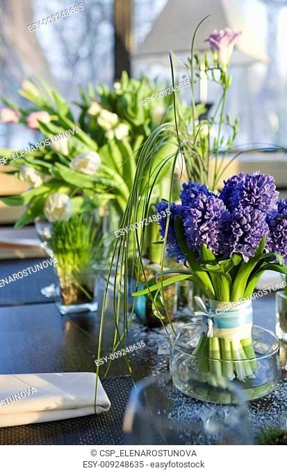 decoration of dining table. bouquet of hyacinth in vase of glass