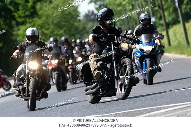 "09 May 2018, Germany, Berlin: The Russian motorcycle gang """"Night Wolves"""" driving through Berlin on """"Victory Day"""". Russia and the other former Soviet..."