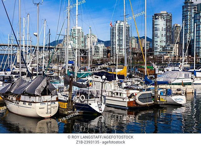 Sailing vessels moored at a private marina in False Creek, Vancouver