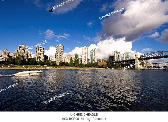 Motorboat cruising towards the Burrard street bridge, Vancouver, British Columbia, Canada