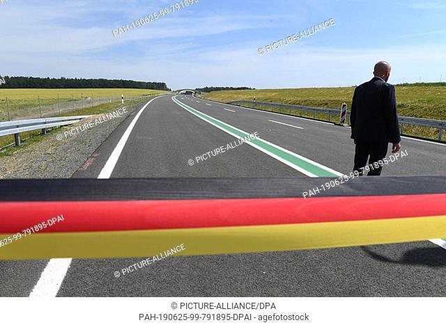 25 June 2019, Mecklenburg-Western Pomerania, Samtens: Security personnel guard the construction site of the new federal road B 96 near Samtens before the...