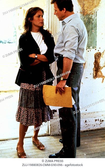 Aug 26, 1988; Calgary, Alberta, CANADA; DEBRA WINGER as Katie Phillips/Cathy Weaver and JOHN HEARD as Michael 'Mike' Carnes in the romantic, action
