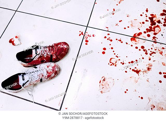 Bloodied sneakers of a deadly injured gang member, lying next to a splash of blood, are seen on the floor of the emergency department of a public hospital in...