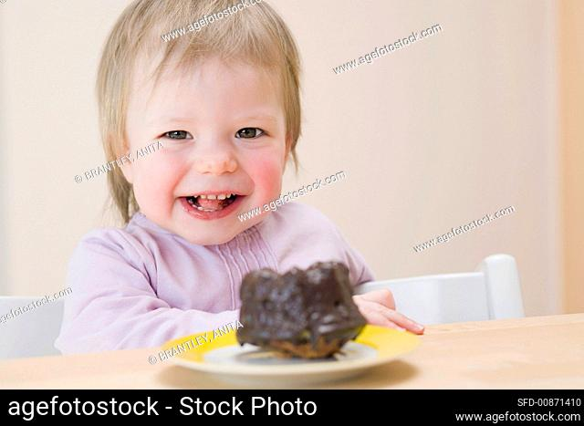 Small girl with a chocolate gugelhupf
