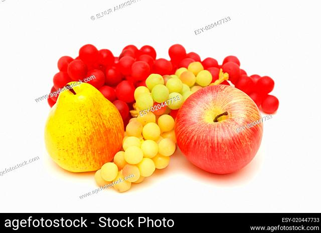 Peach, apple and grapes isolated on white