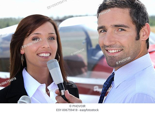 Reporter interviewing young man