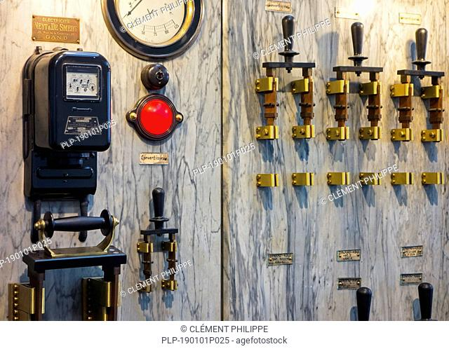 20th century electric switchboard showing switches, gauges and meters on marble panel at MIAT / Industriemuseum, Ghent, East Flanders, Belgium