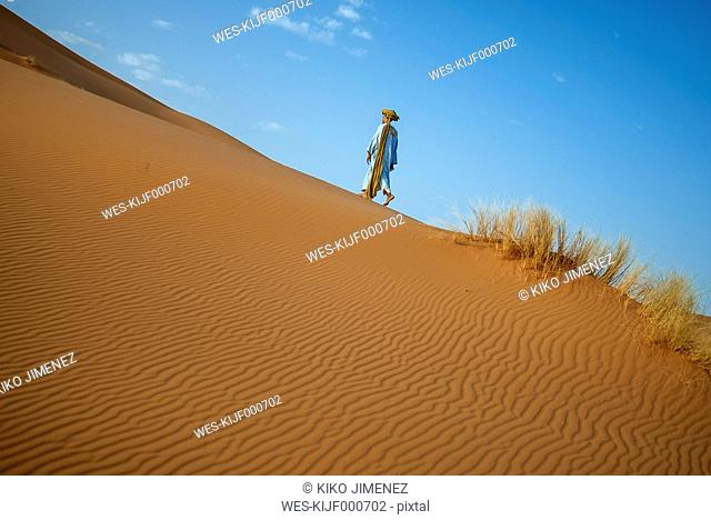 Berber walking in desert