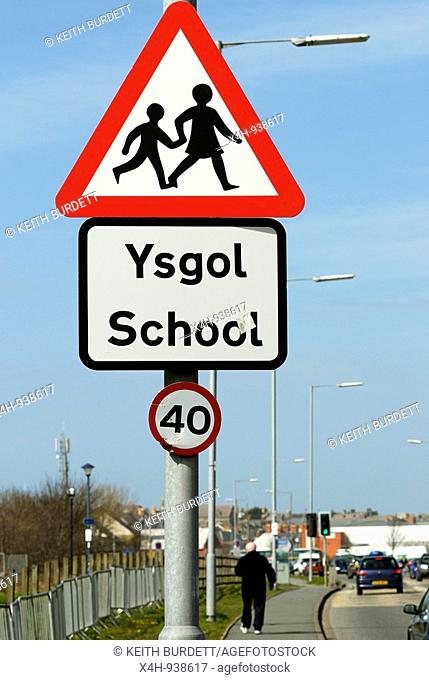 Children crossing warning sign with Tetra mast in background, Aberystwyth, Wales
