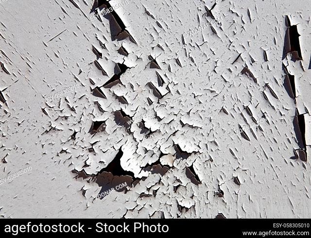 Old white paint on a metal surface