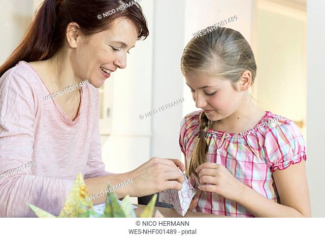 Mother and daughter tinkering